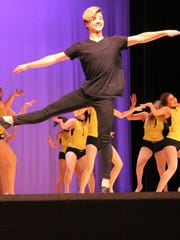 "Dustin Franco, a member of the CHS Dance Company, performed a brief solo in one of the routines during ""FEVER"" dance show."