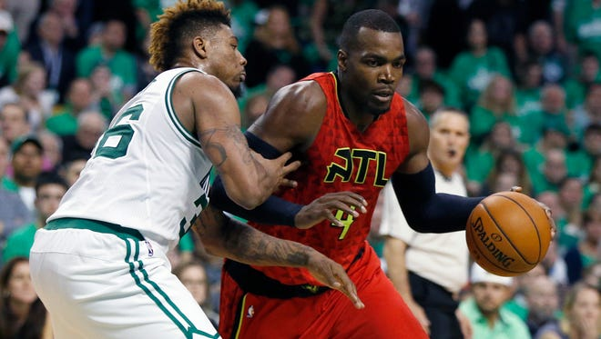 Atlanta Hawks' Paul Millsap (4) is guarded by Boston Celtics' Marcus Smart (36) in Game 4.
