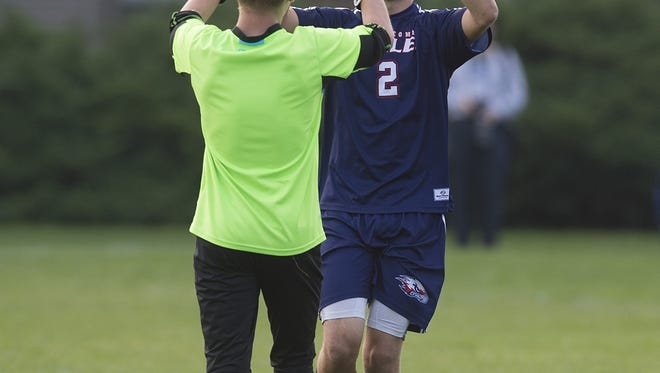 Ryan Zonnefeld and Michael Bradley of Liberty Common celebrate an Eagles' goal during a game against Heritage Christian on Tuesday.