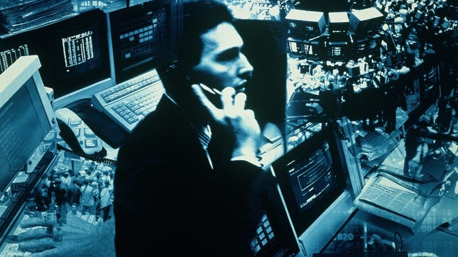 Stock market trader on trading floor.