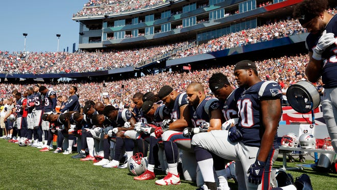 Several New England Patriots took a knee during the national anthem on Sunday.