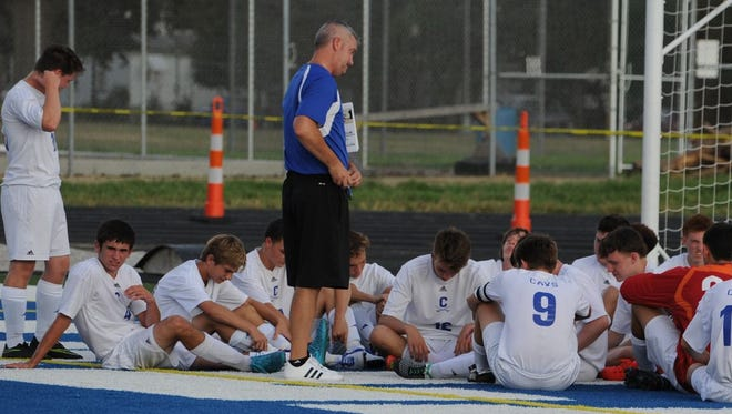 Chillicothe head coach Mike McCorkle talks to his team during halftime of a contest at Herrnstein Field earlier this season. McCorkle has led his Cavaliers to a 69-16-5 record over the past five years.