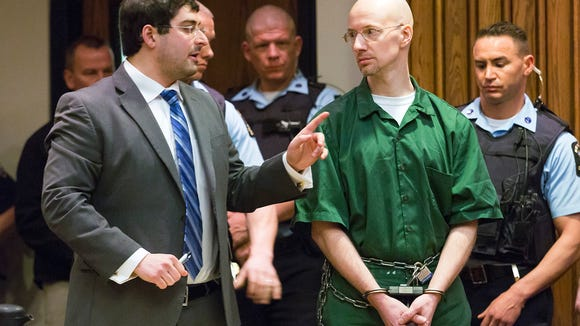 Attorney Joseph Mucia, left, speaks with David Sweat during his sentencing in Clinton County Court Wednesday Feb. 3, 2016, in Plattsburgh, N.Y. Sweat, a convicted killer already serving life behind bars, was ordered Wednesday to pay restitution and sentenced to an additional  3 1/2 to seven years of prison time for his daring escape last year from a maximum-security prison in northern New York. (Gabe Dickens/Press-Republican via AP) MANDATORY CREDIT