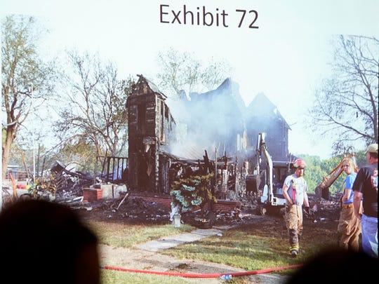 Prosecutors show photographs taken the morning Shirley Exline's Guthrie Center home burned in May 2017 during the murder and arson trial of Patrick Thompson on Thursday, Sept. 27, 2018, at the Monroe County Courthouse in Albia.