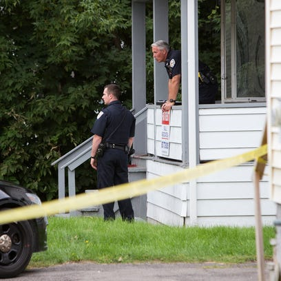 Police investigate the crime scene after two people