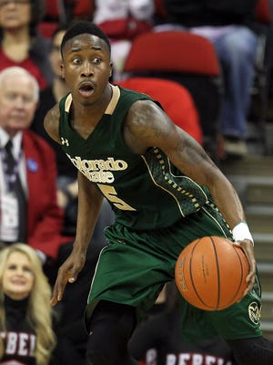Colorado State's Jon Octeus looks to pass during the second half of an NCAA college basketball game against UNLV on Wednesday, Feb. 26, 2014, in Las Vegas. UNLV defeated Colorado State 78-70. (AP Photo/Isaac Brekken)