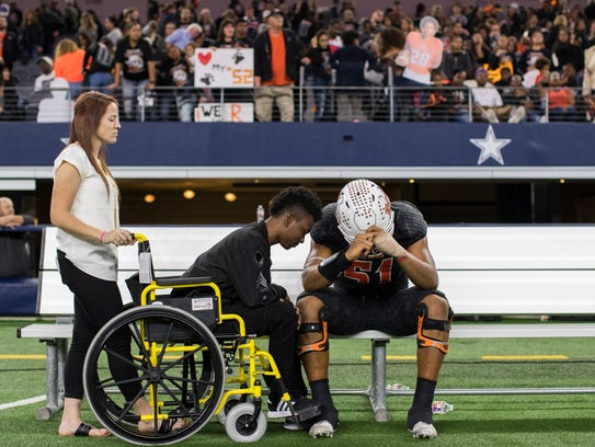 Refugio's Casey Henderson comforts Armonie Brown after