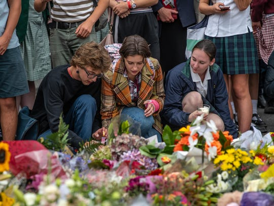 CHRISTCHURCH, NEW ZEALAND - MARCH 18: People place a candle among flowers and tributes near Al Noor mosque on March 18, 2019 in Christchurch, New Zealand. 50 people were killed, and dozens are still injured in hospital after a gunman opened fire on two Christchurch mosques on Friday, 15 March. The accused attacker, 28-year-old Australian, Brenton Tarrant, has been charged with murder and remanded in custody until April 5. The attack is the worst mass shooting in New Zealand's history. (Photo by Carl Court/Getty Images) ORG XMIT: 775315734 ORIG FILE ID: 1131337731