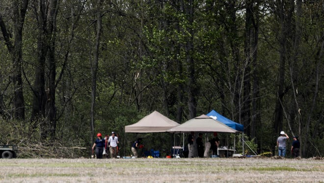 Police and the FBI search a wooded area near 23 Mile Road and North Avenue in Macomb Township where police believe the body of Kimberly Alice King and other missing young girls might be buried on Wednesday, May 9, 2018.