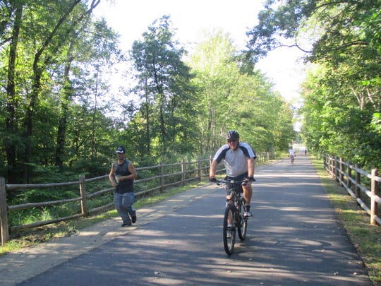 Bikers and joggers make use of the Dutchess Rail Trail.
