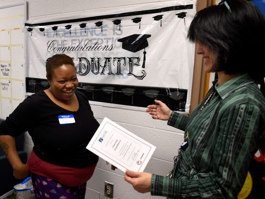 Cherrelle Grandberry is presented a certificate of