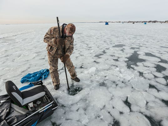 Deep freeze puts great lakes on ice for Ice fishing lake st clair