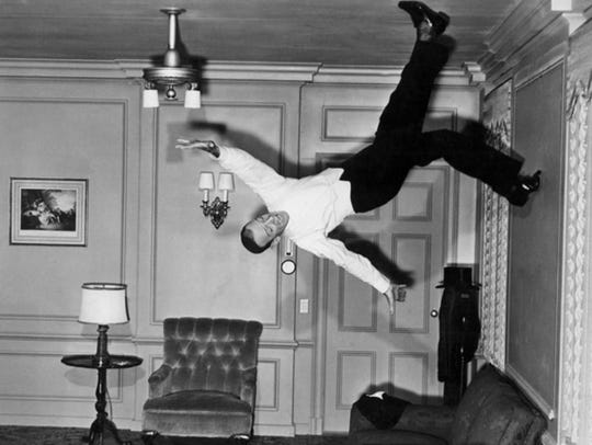 Fred Astaire dances around the room (and provides inspiration