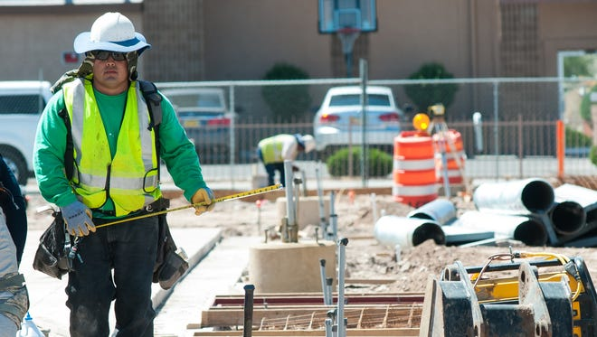Workers continue construction on a civic plaza on Monday, April 25, 2016, the project is expected to be completed in August.