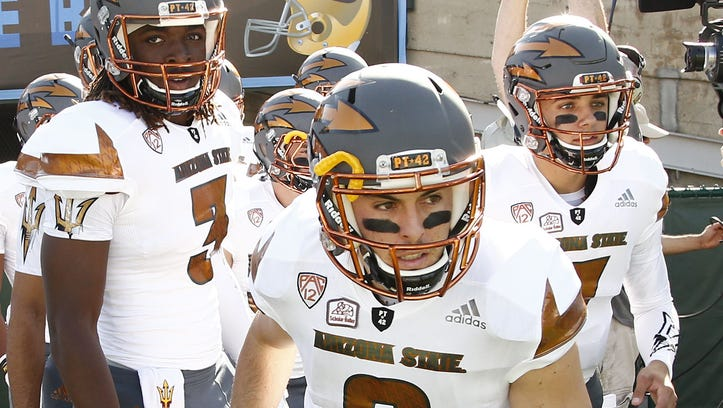 ASU's Mike Bercovici takes the field to battle UCLA