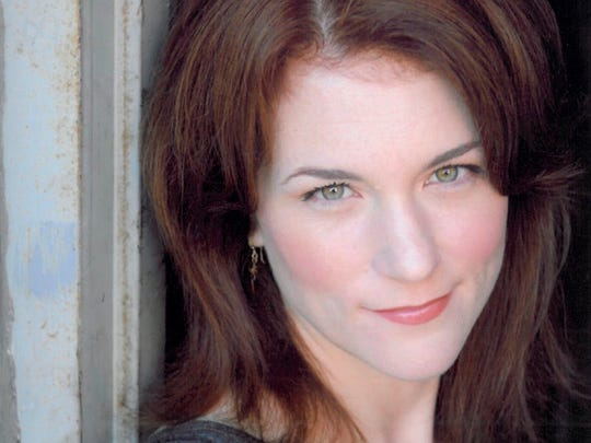 """This photo provided by Cathy Taylor Public Relations, Inc., shows Molly Glynn. Glynn, an accomplished Chicago theater actress who also played a recurring role as a doctor on the TV series """"Chicago Fire,"""" has died after a tree toppled by a powerful storm struck her as she rode her bike in a forest park."""