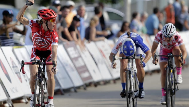 Tina Pic raises her fist in the air Thursday after winning the Pro Women 1/2 division during the Tour of America's Dairyland Neenah Rocket Criterium in Neenah.