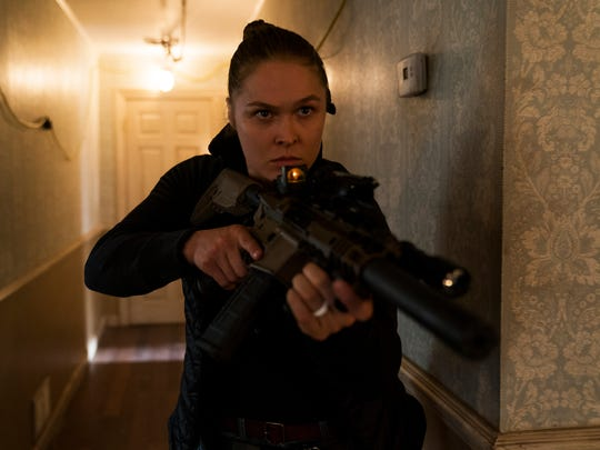 "Ronda Rousey stars as Sam Snow in the STXfilms release ""Mile 22."""