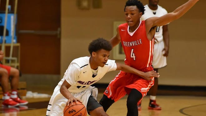 Hillcrest's Cameron Hunter is pressured by Greenville's Dorian Williams.