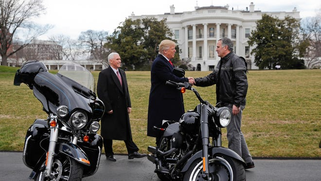President Donald Trump and Vice President Mike Pence greet Matthew S. Levatich, Harley-Davidson president and CEO, outside the White House during a meeting in February.