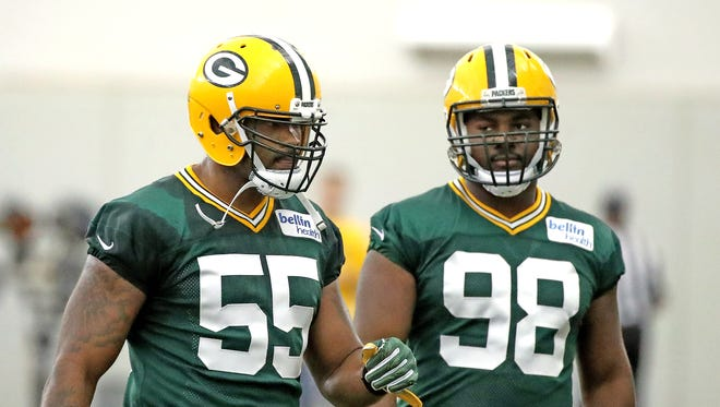 Green Bay Packers linebacker Ahmad Brooks (55) with linebacker Chris Odom (98) during Green Bay Packers practice Wednesday, September 6, 2017 inside the Hutson Center.