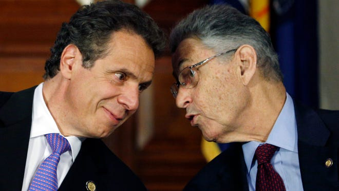 In this June 19, 2014 file photo, New York Gov. Andrew Cuomo, left, and Assembly Speaker Sheldon Silver, D-Manhattan, talk during a news conference announcing an agreement on legislation legalizing medical marijuana in Albany, N.Y. Even after his arrest on federal corruption charges, Silver remains one of the most powerful politicians in New York.