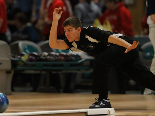 Yorktown's Matt Meyers throws two-handed during the Section 1 boys bowling championships in Fishkill on Tuesday, Feb. 9, 2016.