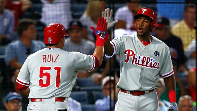 Carlos Ruiz of the Philadelphia Phillies celebrates his solo homer in the fifth inning against the Atlanta Braves with Maikel Franco at Turner Field on September 2 in Atlanta, Georgia.  (Photo by Kevin C. Cox/Getty Images)