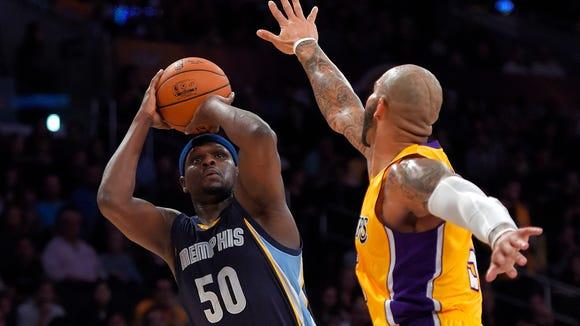 Memphis forward Zach Randolph, left, puts up a shot Los Angeles Lakers on Sunday.