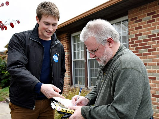 Chesapeake Bay Foundation volunteer David McGee, left, of Manchester Township, directs Bob Rambo, right, of Springettsbury Township, as he signs a petition to be sent to Governor Wolf, as part of the Clean Water Counts in York campaign in York, Pa. on Saturday, Oct. 24, 2015. Dawn J. Sagert - dsagert@yorkdispatch.com
