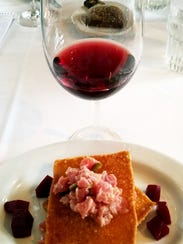 Dolphin Bar's tuna tartare stack paired with a Rodney