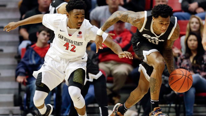 Grand Canyon University guard Dominic Magee, right, dribbles as San Diego State guard Jeremy Hemsley defends during the first half of an NCAA basketball game on Friday, Dec. 18, 2015, in San Diego.