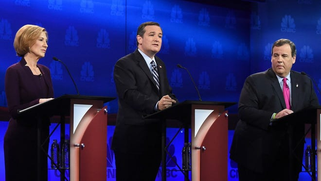 Republican Presidential hopeful Ted Cruz speaks as Carly Fiorina and Chris Christie look on during the CNBC Republican Presidential Debate, October 28, 2015 at the Coors Event Center at the University of Colorado in Boulder, Colorado.