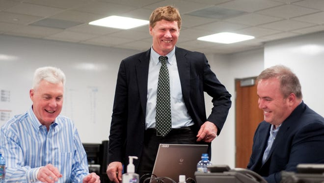 Packers general manager Ted Thompson, left, shares a laugh with team President and CEO Mark Murphy and coach Mike McCarthy in the draft room in 2013.