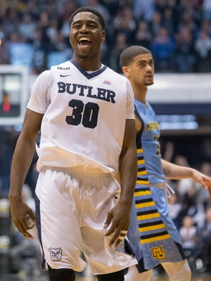 Kelan Martin of Butler smiles after hitting a three point shot in a late first half run for the Bulldogs, Marquette at Butler, men's basketball from Hinkle Fieldhouse, Saturday, March 5, 2016.