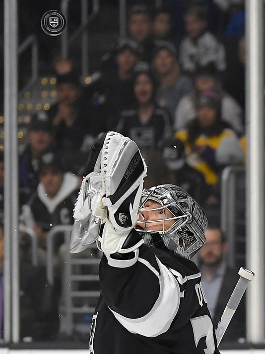 Los Angeles Kings goalie Jonathan Quick makes a glove-save during the first period of an NHL hockey game against the Boston Bruins, Thursday, Nov. 16, 2017, in Los Angeles. (AP Photo/Mark J. Terrill)