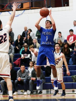 Pearl River's Stephen Lappas (1) puts up a shot in front of  Eastchester's Nick Milo (22) during boys basketball action at Eastchester High School Feb. 16, 2017. Pearl River won the game 63-44.