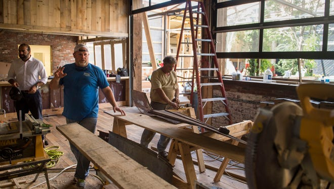 Owner Pat Martin, second from left, gives a tour of the future location of Martin's Bar-B-Que Joint, 410 4th Avenue S, Thursday, June 16, 2016, in Nashville, Tenn.