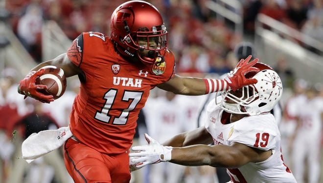 Utah wide receiver Demari Simpkins (17) stiff-arms Indiana defensive back Tony Fields (19) after a reception during the first half of the Foster Farms Bowl NCAA college football game Wednesday, Dec. 28, 2016, in Santa Clara, Calif.