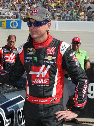 Kurt Busch stands by his car prior to the AAA 400 at