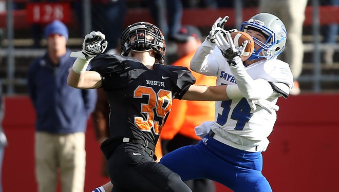 Middletown North's Marc Cerbo breaks up a pass to Sayreville receiver Connor Holmes in North 2 Group IV sectional football championship at Rutgers University's High Point Solutions Stadium.
