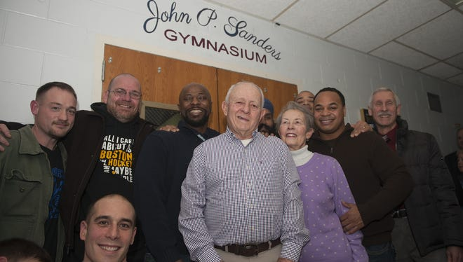 Eastern High School's former wrestlers gathered with former coach John Sanders after the school and Camden County Board of Education dedicated named the wrestling gym on Wednesday night.