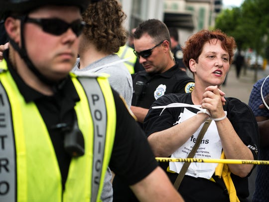 Beth Foster, right, of Chattanooga, Tenn., and other participants in the Poor People's Campaign are arrested at 5th Ave. North and Gay St. in Nashville, Tenn., Monday, May 21, 2018.