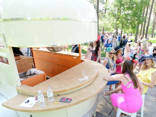 Champagne Charlie's Mobile Bars serve guests at Shreveport Derby Day.