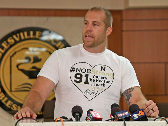 Teacher Jason Seaman, shown speaking at a news conference on May 28, 2018, was shot three times in the Noblesville school shooting three days earlier and is credited with helping to stop the attack.