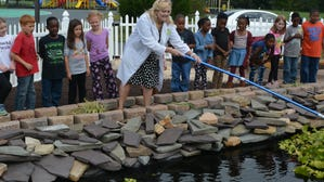 Community comes together to build pond at Snow Hill school