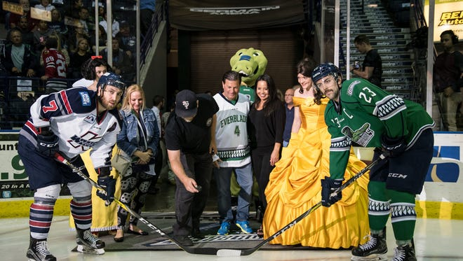 Chris Scodder drops the ceremonial puck before the Florida Everblades' game on Saturday, April 1, 2017. Scodder was honored as the team's four-millionth fan.