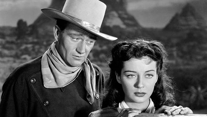 "John Wayne and Gail Russell in ""Angel and the Badman."""