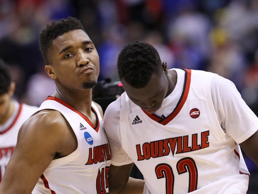 U of L's Donovan Mitchell (45) and Deng Adel (22) were