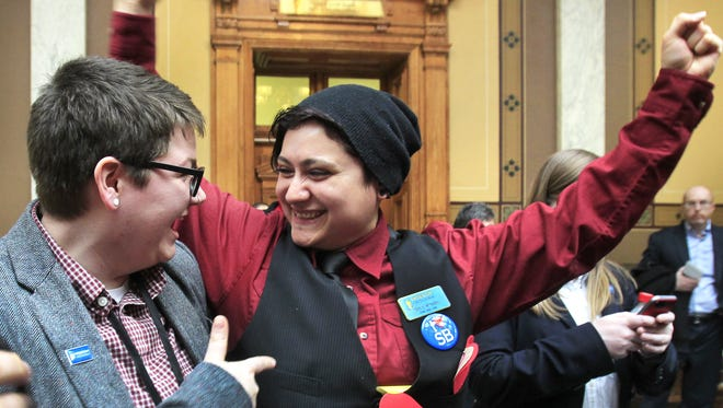 Jess Novak, 23, Indianapolis (left), and Aimee Mendez, 30, South Bend, cheered the Senate's move Thursday. Mendez is a field organizer for Freedom Indiana, which opposed HJR-3.
